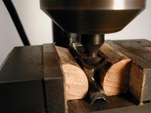Cutting the ferrule-shaped groove by moving the cutter into the frog.