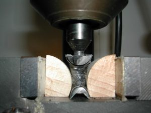 The cutter clamped into the milling head and centered on the frog.